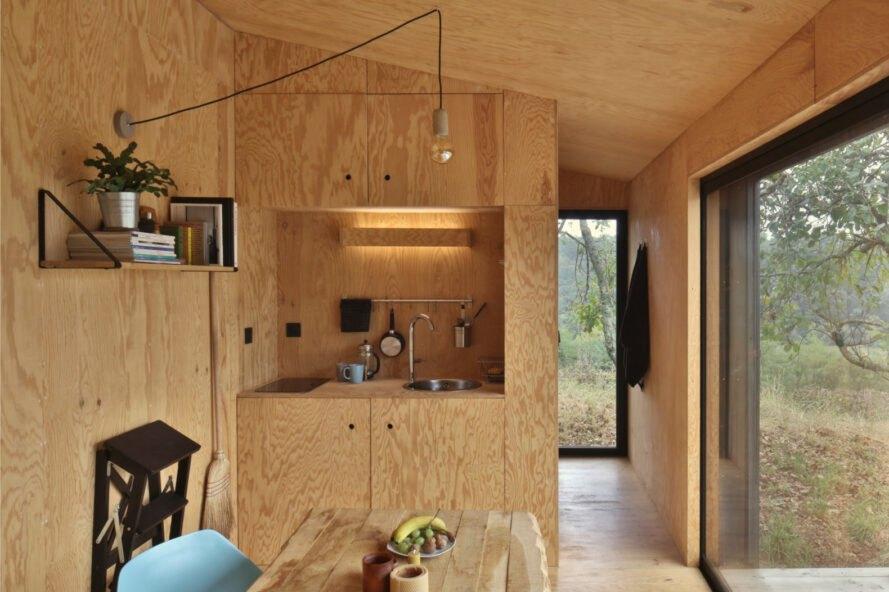 interior of cabin with natural wood walls and furnishings