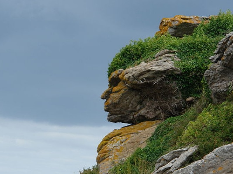 Rock formation in Ebihens, France, looking exactly like a man's face in profile.