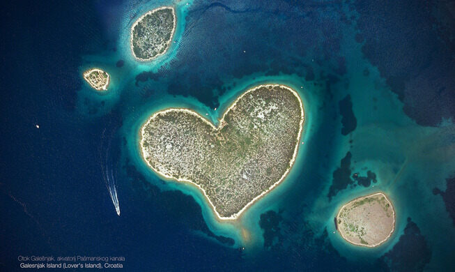 A heart-shaped island surrounded by blue water.