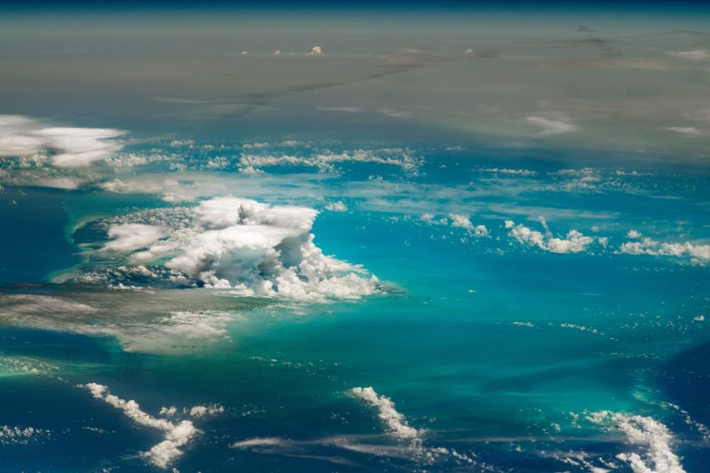 Clouds floating over an expanse of blue.