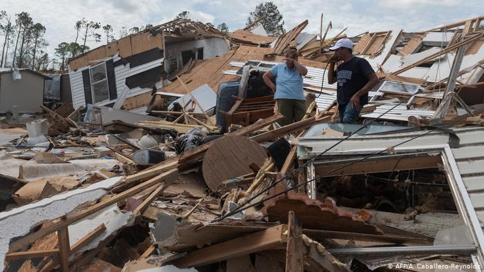 A couple react as they go through their destroyed mobile home following the passing of hurricane Laura in Lake Charles, Louisiana, on August 27, 2020