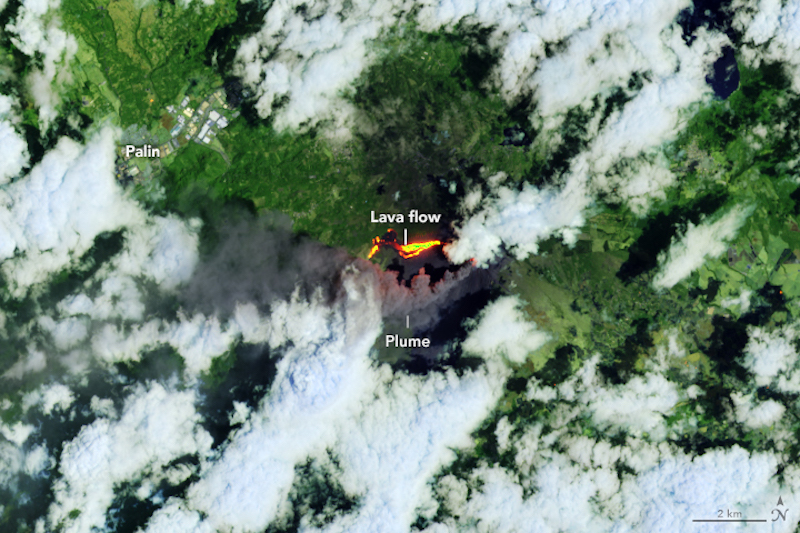 Orbital view of white clouds over green forest with two glowing yellow-orange patches labeled lava.