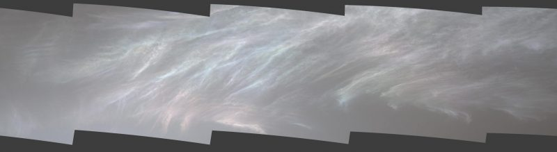Wispy white clouds with glowing pinks and blues.