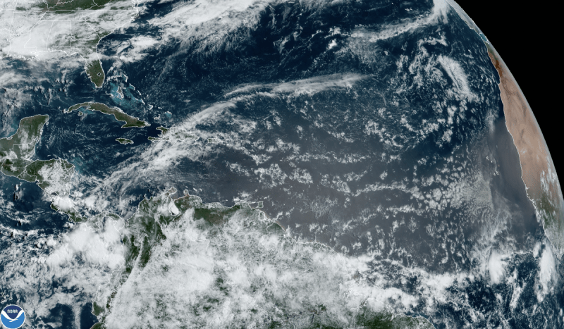 Satellite view of clouds over the Atlantic with west coast of Africa barely visible on right.