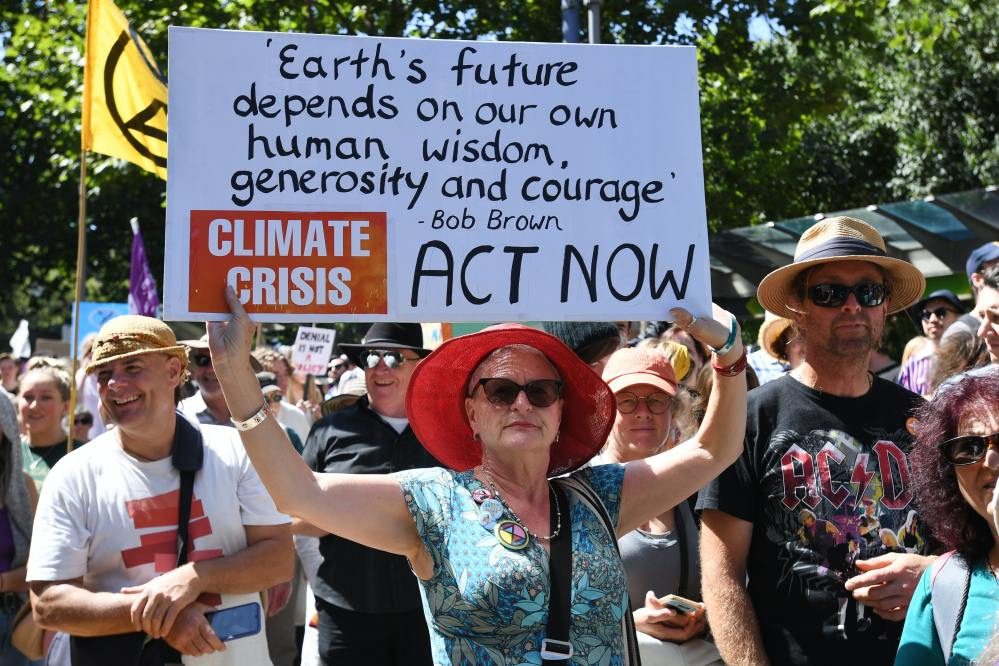 Women holds sign at climate march