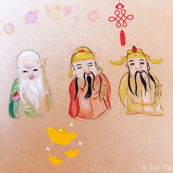 Pictures (or carvings?) of 3 slant-eyed men in flowing robes.