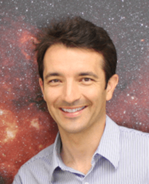 Smiling man with stars behind him.