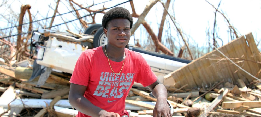 Fifteen-year-old Benson Etienne and his family escaped before their house collapsed in the hurricane-hit Marsh Harbour, in Abaco Island, Bahamas.
