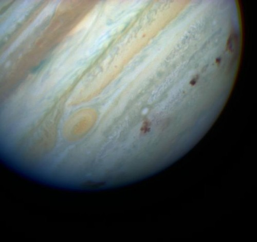A line of brown dots along southern hemisphere of Jupiter.