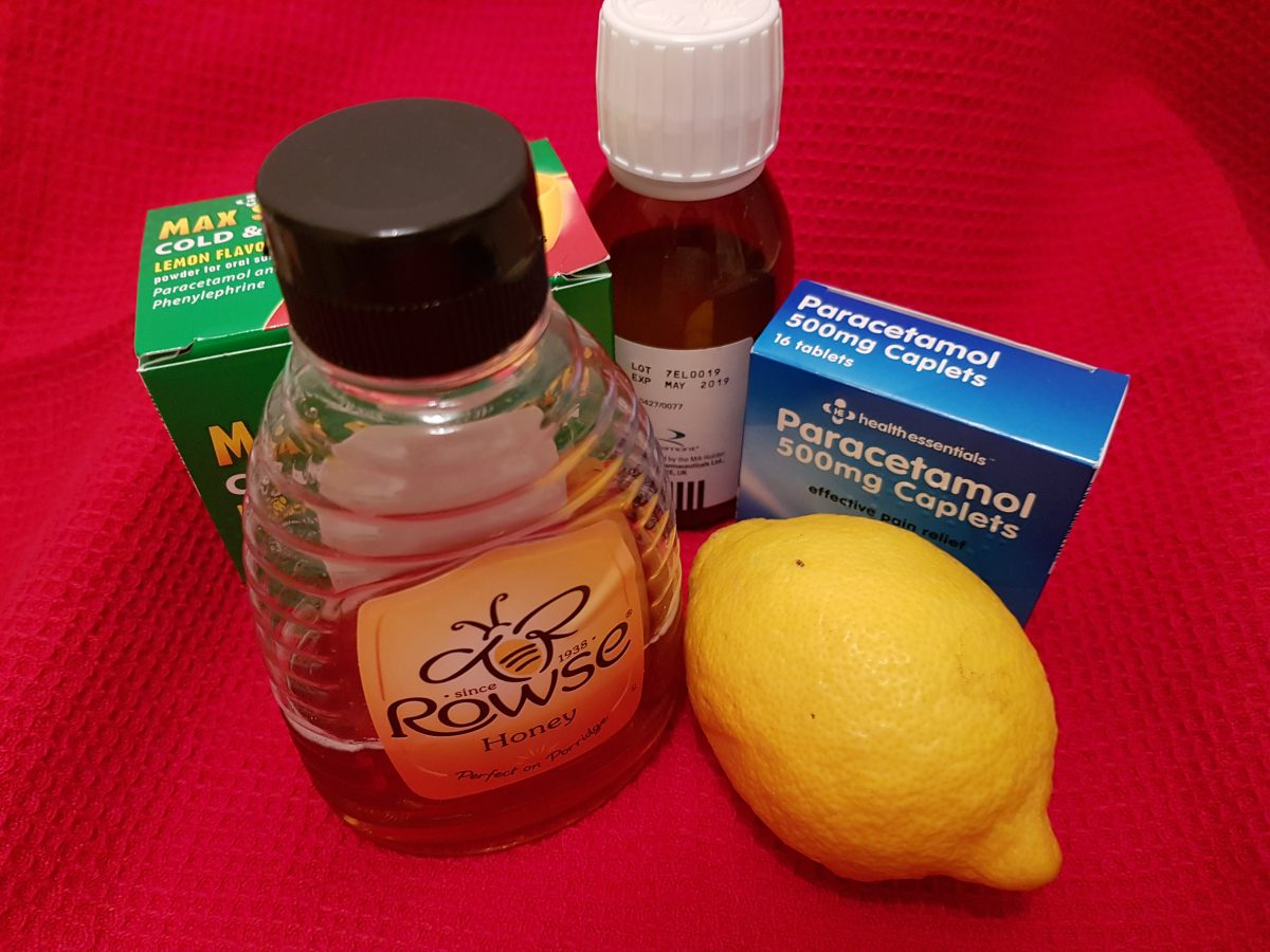language learning - a bottle of honey, a lemon, cold medication packets