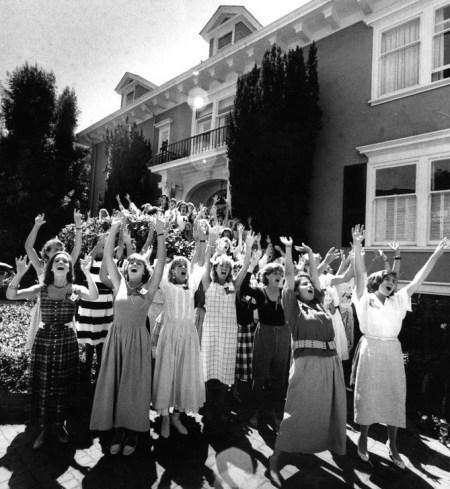 cheerful women celebrating outside of a bujilding