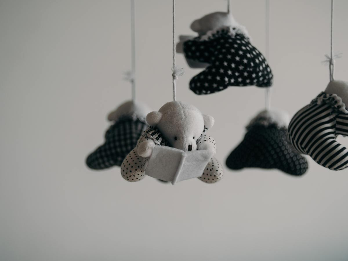black and white mobile of teddy bears