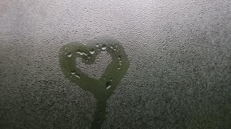 heart drawn in condensation