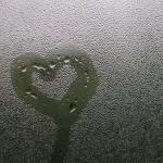 heart drawn in condensation