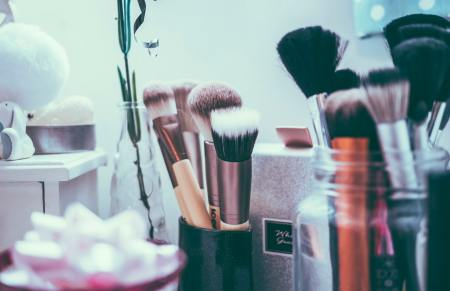 make up brushes on a vanity table