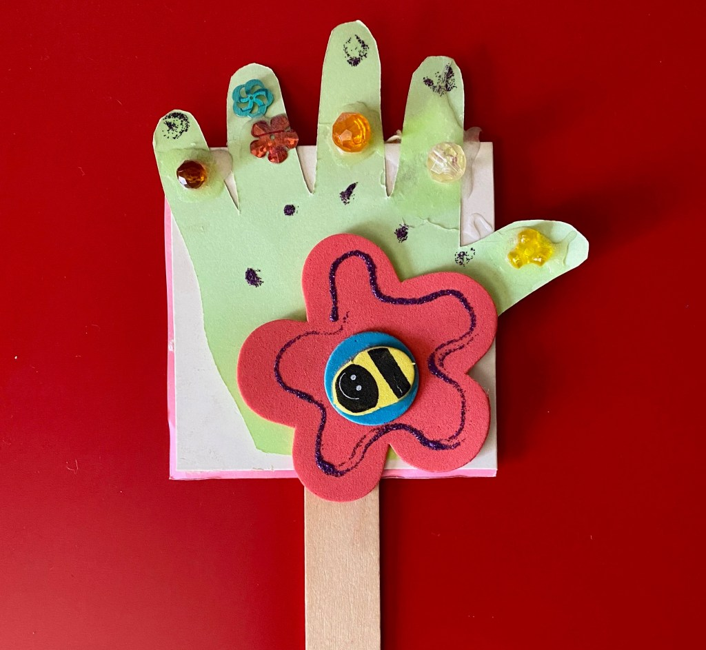 homemade handprint on popsicle stick