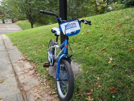 kid's bike with Harris/Biden sticker on it