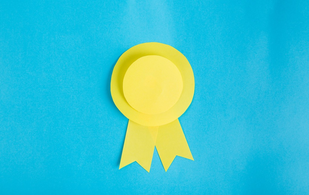 yellow rosette on blue background