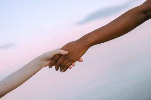 photo of people holding each other s hands