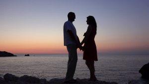 Couple Beside The Ocean