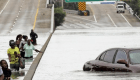 Hurricane Victims wade through floowaters on Houston freeway.
