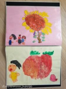 ファイルに入れた四つ切り画用紙に描いた子供の絵