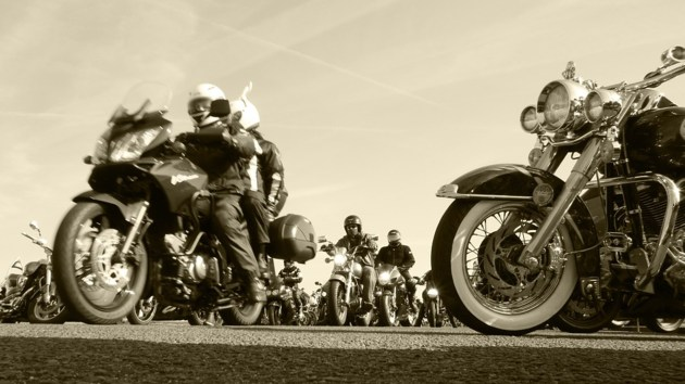 Large group of motorcycle riders on the road