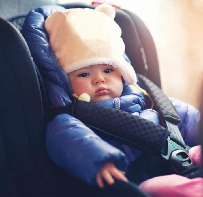 Why do puffy winter coats compromise car seat safety