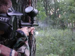 A man playing long distance paintball game using the best long range paintball gun