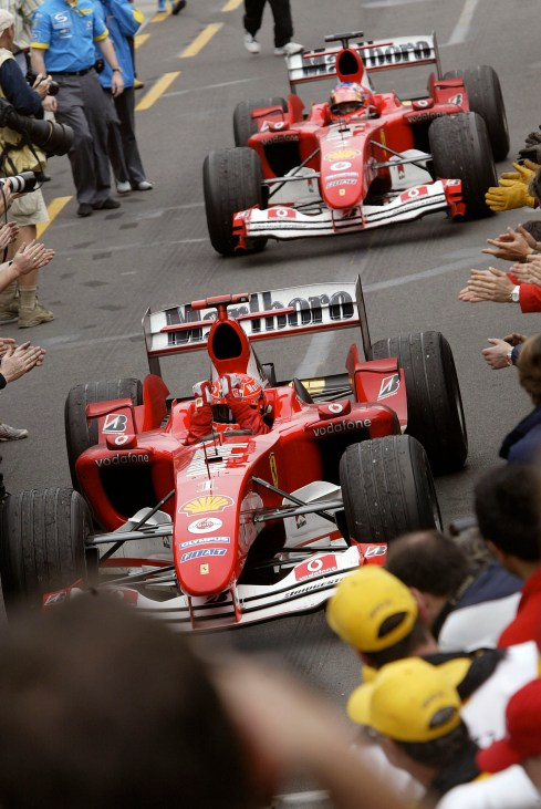2004 Australian Grand Prix-Sunday race Melbourne, Australia. 7th March 2004 Rubens Barrichello, Ferrari F2004 follows Michael Schumacher, Ferrari F2004 into Parc Ferme. World Copyright: Mark Horsburgh/LAT Photographic ref: Digital Image only
