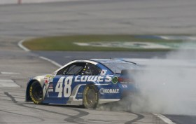 Jimmie Johnson celebrates at Atlanta Motor Speedway with a burnout after winning the Folds of Honor QuikTrip 500, adding to his legacy with career victory No. 71. Just five behind NASCAR legend Dale Earnhardt on the all-time wins list.