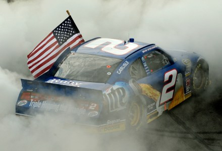 LONG POND, PA - AUGUST 07:  Brad Keselowski, driver of the #2 Miller Lite Dodge, celebrates with a burnout after winning the NASCAR Sprint Cup Series Good Sam RV Insurance 500 at Pocono Raceway on August 7, 2011 in Long Pond, Pennsylvania.  (Photo by Jared C. Tilton/Getty Images)