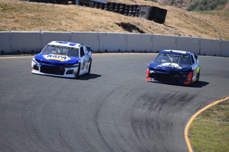Chase Elliott (9) moves by Alex Bowman (88) heading into the corner.