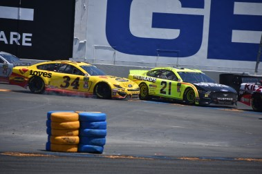 Michael McDowell (34) came in hot and ran into Paul Menard (21), sending him into a spin in Turn 11.