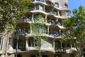 Part of an unusual apartment building showing rows of windows in a flowing matrix reminiscent of a honeycomb
