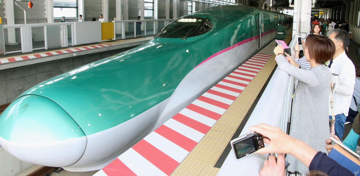 Looking like a wicked flying turquoise eel, Hokkaido Shinkansen marks 1 year since launch