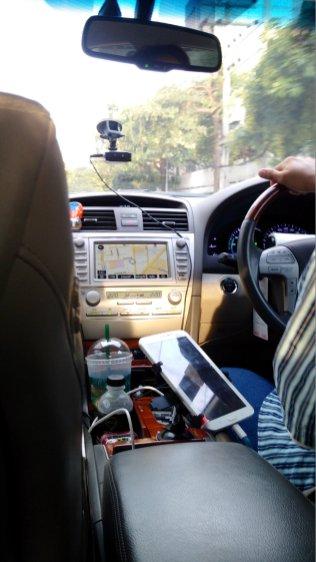 "Another GrabTaxi service, a high-end ""GrabCar"""