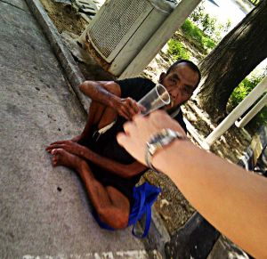 Elder, homeless and begging in the heart of capitalistic Kuala Lumpur.