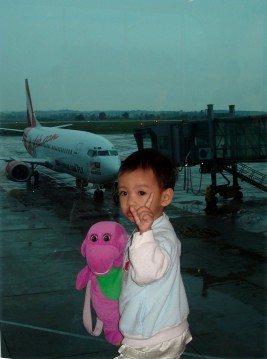 My son with his Barney during our trip back to our hometown, Muar, Johor. This photo was taken at Senai Airport, JB.