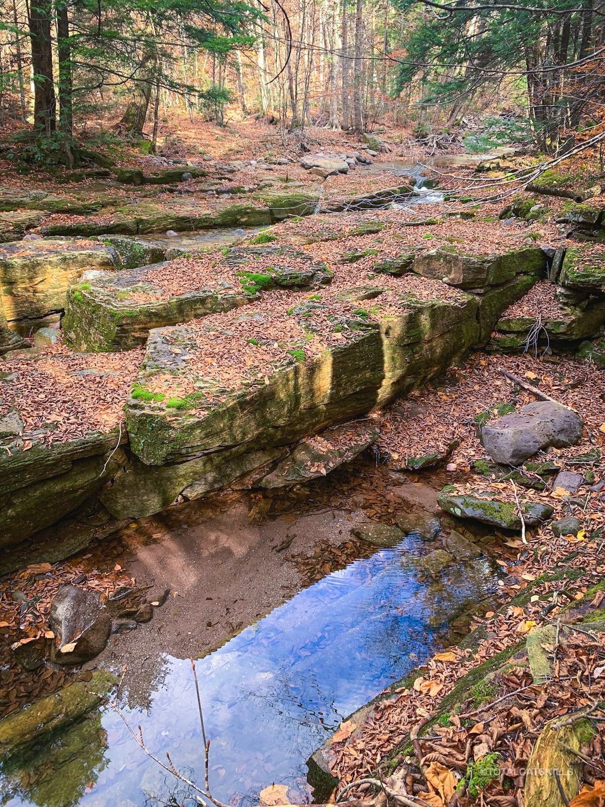 fisherman's path boulders in stream