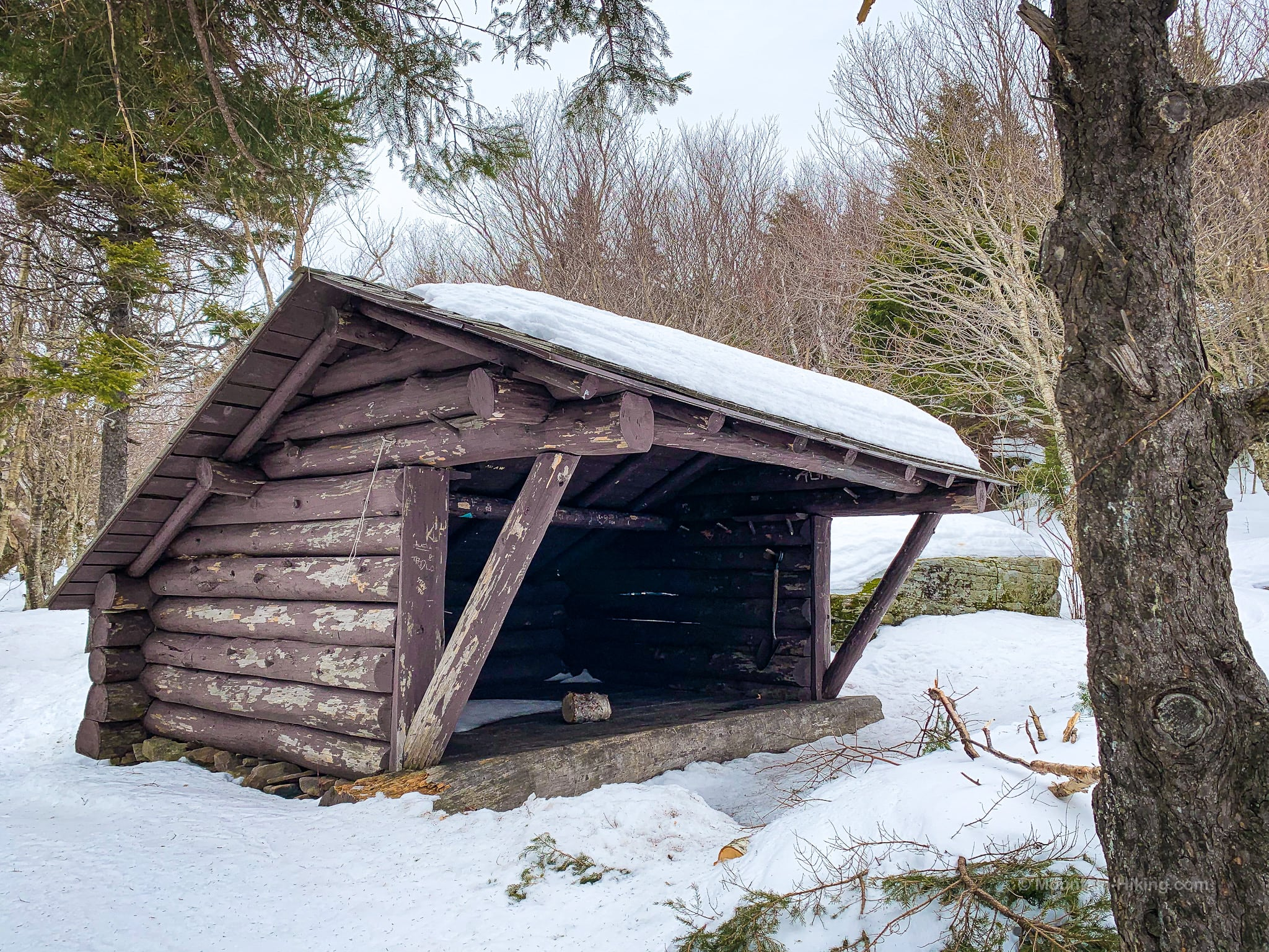 Wooden lean-to in deep snow