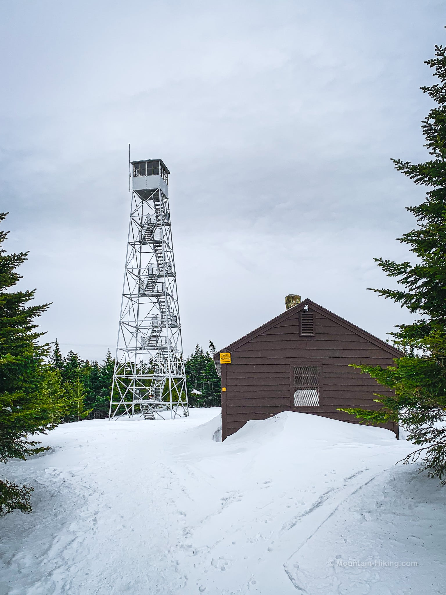 fire tower and cabin in snow