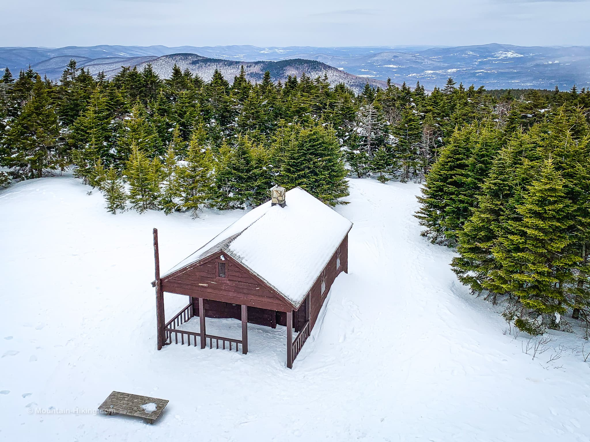 cabin in snow on mountain summit