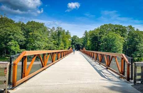 orange steel and concrete bridge