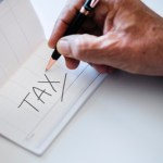 Tax Photo by rawpixel on Unsplash