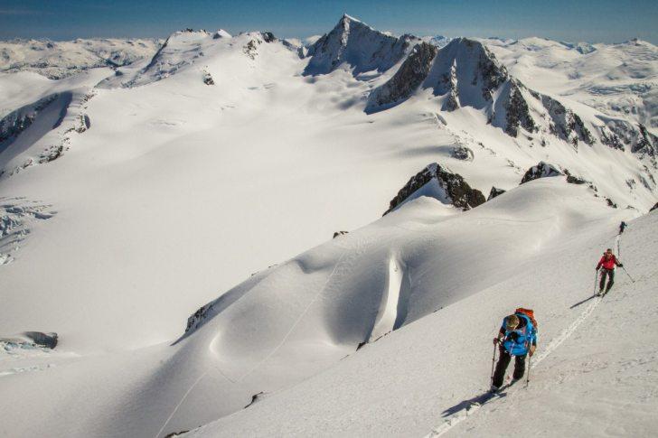Ski tourers in the Coast Mountain Range near Wahoo Tower