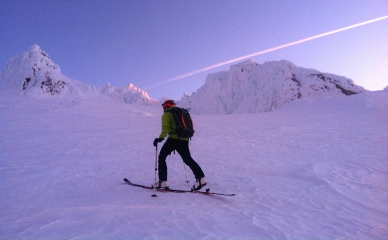 Skinning upwards in the dawn light, featuring an elusive ski crampon sighting.