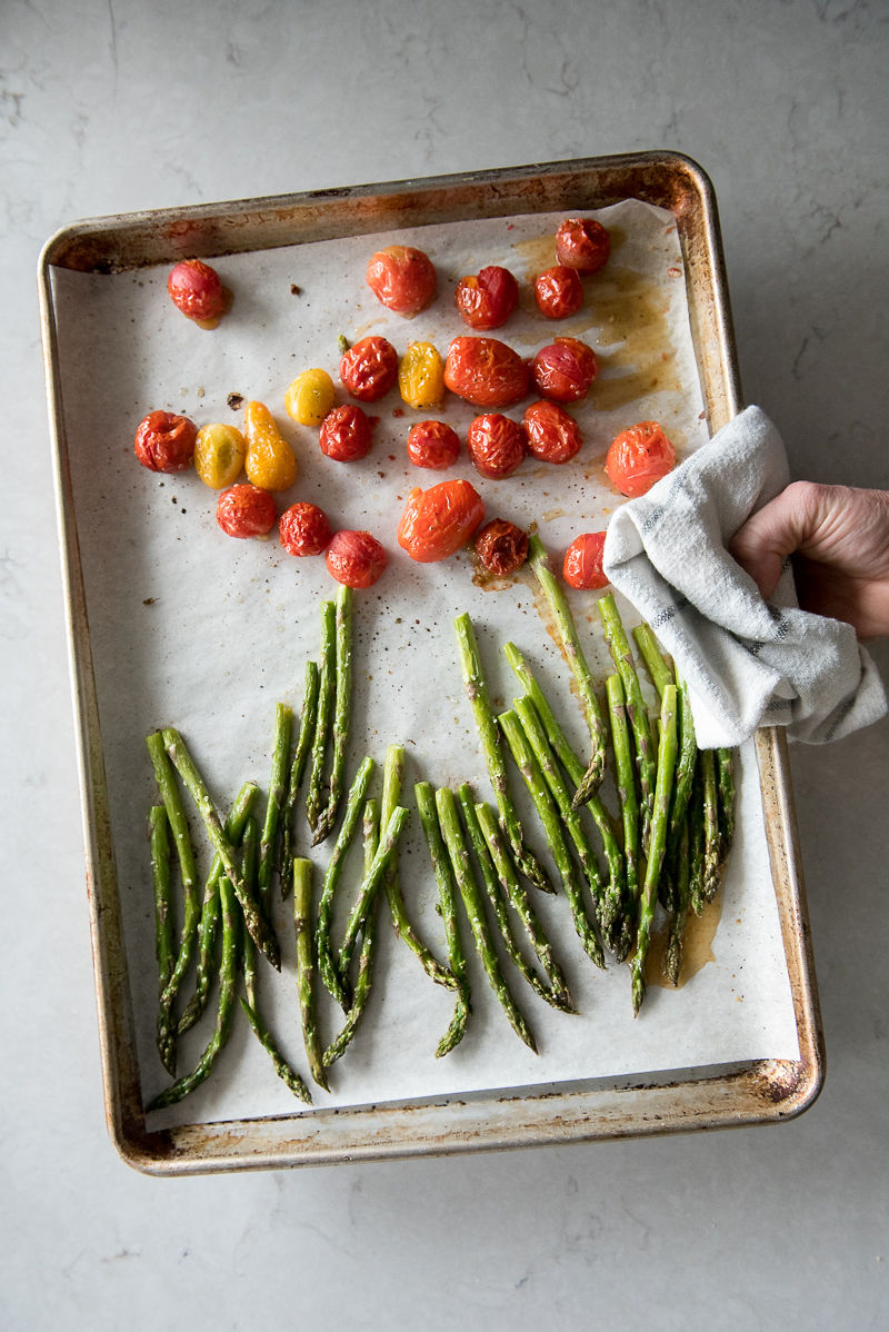 roasted asparagus and tomatoes on sheet pan
