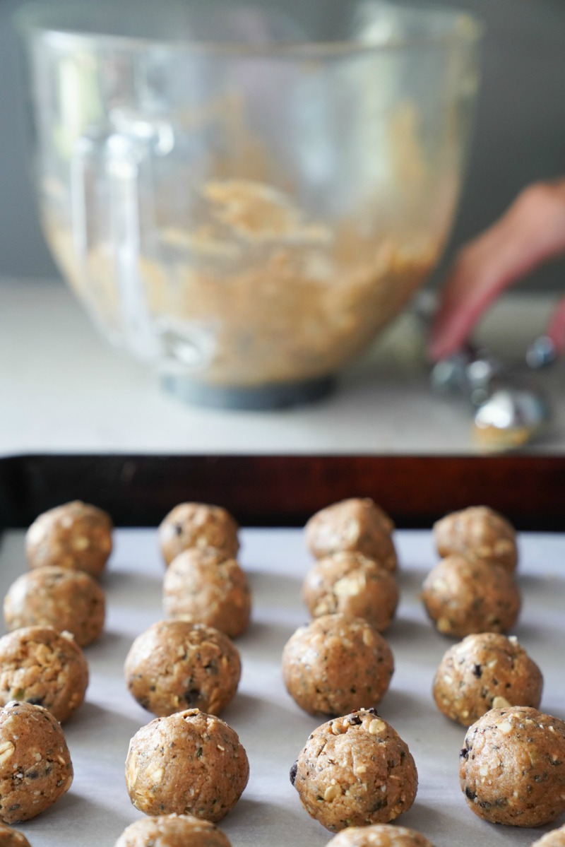 Using a cookie scoop to make even protein balls. These protein balls are made with Kodiak cakes pancake mix, nut butter, and honey.