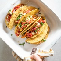 crispy corn shells, refried, beans, roasted veggies for delicious vegetarian tacos. www.mountainmamacooks.com